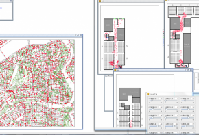 本システム画面は、JR大阪駅周辺における避難行動シミュレーションのシステム画面である。左の図では地上における避難行動の様子を、右の図では建物内における様子を示しており、赤い丸は避難者を表しています。